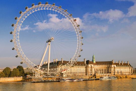 London, UK - September 19, 2014: View of the London Eye in afternoon on September 19, 2014. The London Eye is a famous tourist attraction on river Thames in the capital city London.