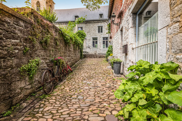 Fotomurales - Cobblestone alley in the old city center of Durbuy, Wallonia, Belgian Ardennes.