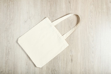 White cotton eco bag on wooden background