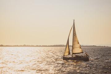 Yacht in the sea at sunset in Mediterranean sea, Turkey