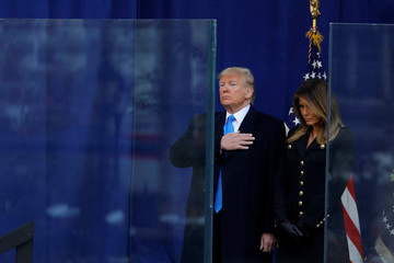 U.S. President Donald Trump and first lady of the United States Melania Trump pause during a moment of silence at a Veterans Day Parade and Wreath Laying ceremony in Manhattan, New York City