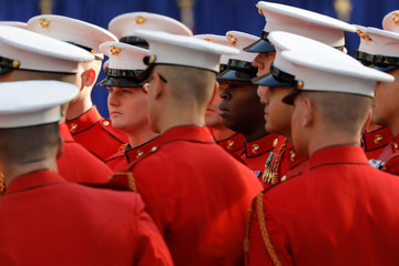 The Commandant's Own United States Marine Drum & Bugle Corps gather ahead of a Veterans Day Parade and Wreath Laying ceremony attended by U.S. President Donald Trump in Manhattan