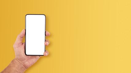 Smartfon, telefon w męskiej dłoni na żółtym tle Wall mural