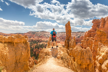 Male tourist enjoying the scenic view at the Bryce Canyon, Utah Wall mural