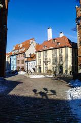 Walking people near St. John's Evangelical Lutheran Church, Skarnu Iela, European historical and cultural Riga Old Town. Latvia