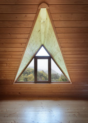 Wooden and modern attic room with window