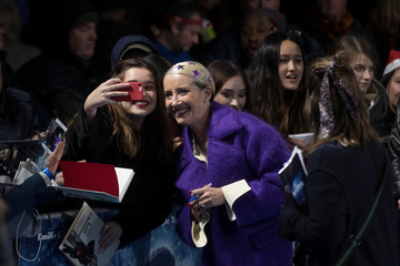 """Actor Emma Thompson poses for a photograph with fans as she arrives for the U.K. premiere of """"Last Christmas"""" in London"""