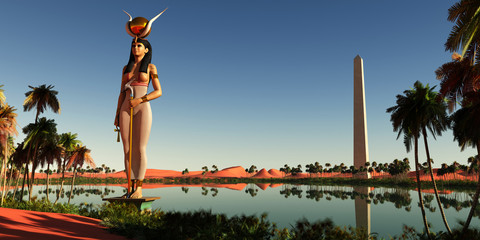 Hathor Statue in Egypt - Hathor was the symbolic Egyptian mother of the pharaohs. Here she stands as a statue near an obelisk by the Nile river.