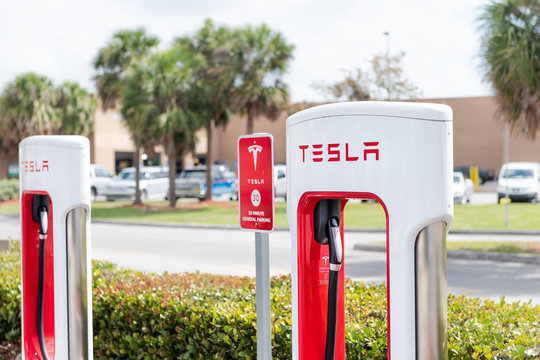 Homestead, USA - May 2, 2018: Closeup of Tesla Super Charging electric car station in shopping mall with nobody