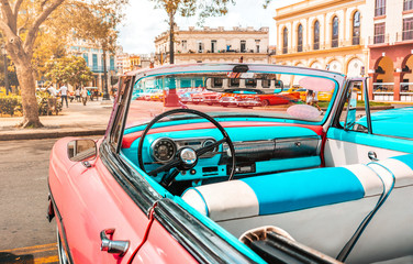 Pink old american classic car in Havana, Cuba
