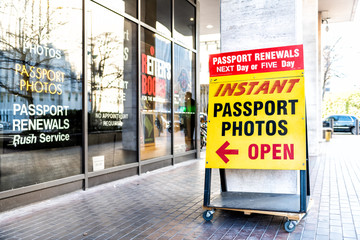Washington DC, USA - March 9, 2018: Passport photo service, professional photography business, passport renewal store, shop sign on sidewalk in Washington Travel Agency, District of Columbia