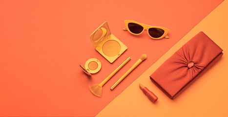 Fashion beauty product layout. Woman Essentials cosmetic makeup Set. Collection beauty accessories. Trendy Clutch, Brushes, lipstick. Coloful orange coral art Flat lay. Creative make up artist concept