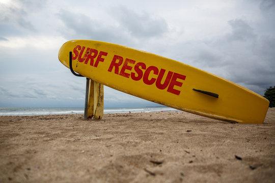 Surf rescue board on beach.