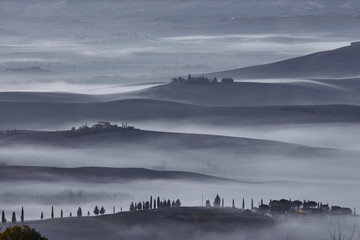 Poster Grijs Tuscan landscape at sunrise under the fog