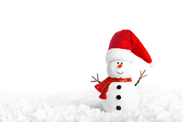 Toy of snowman on snow over white background