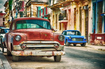 Havana street in Cuba with old red american car
