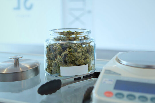cannabis buds in jar with scale for sale