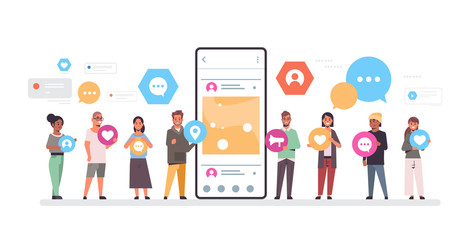 people group holding different types of communication icons mix race men women standing together near smrtphone screen online mobile app social network concept full length horizontal vector