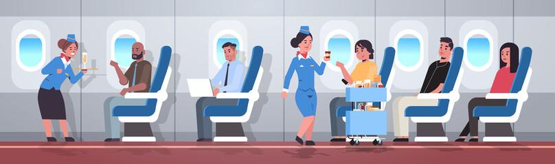 flight attendants serving mix race passengers stewardesses in uniform offering drinks professional service travel concept modern airplane board interior full length horizontal flat vector illustration