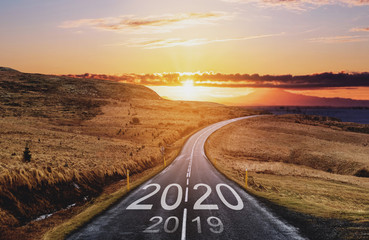 2020 and 2019 on the empty road at sunset. New Year concepts Fotomurales