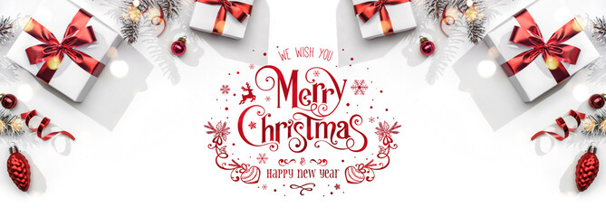 Fototapete - Merry Christmas and New Year text on white background with gift boxes, ribbons, red decoration, bokeh, sparkles and confetti. Xmas greeting card, bokeh, light. Flat lay, top view