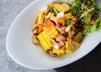 Delicious corn spicy salad, papaya salad, Thai Style food