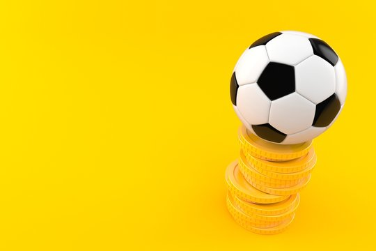 Soccer ball with stack of coins