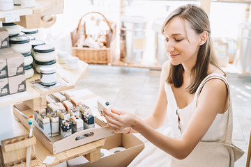 Woman with personal hygiene items in zero waste shop.