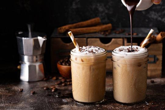 Iced coffee macchiato in two mason jars