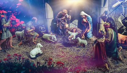 Traditional Christmas scenes and sacred light shining for use in illustration design Nativity scenes with Jesus baby on the manger with carvings, including Jesus, Mary, Joseph, sheep and magi