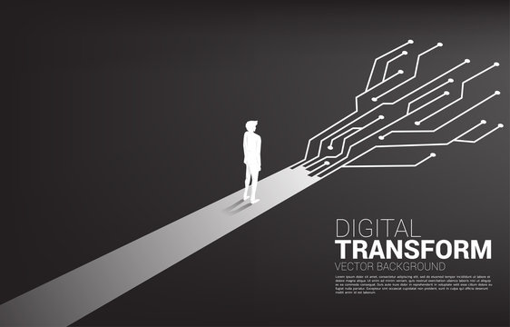 Silhouette of businessman standing on the way with dot connect line circuit. concept of digital transformation of business.
