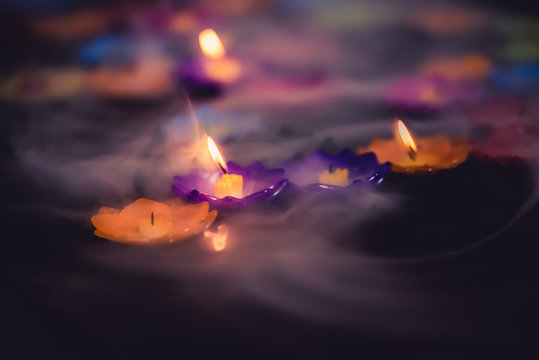 Light of candle in the fog.