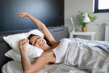 Fototapeta Young beautiful woman waking up fully rested obraz