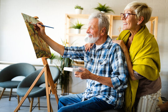 Handsome senior man and attractive old woman are enjoying spending time together