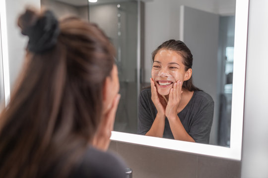 Face wash young Asian woman washing using facial scrub exfoliating skin cleansing of dead cells and oil for black pores clear skincare treatment.