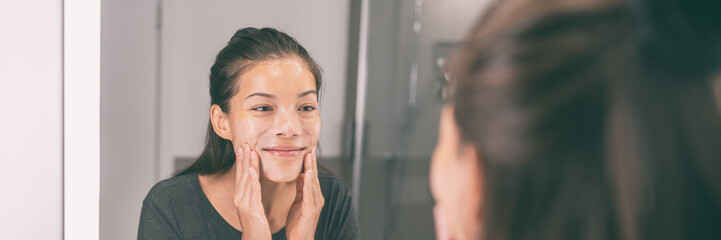 Face wash young Asian woman applying scrub exfoliating skin in beauty skincare routing morning...