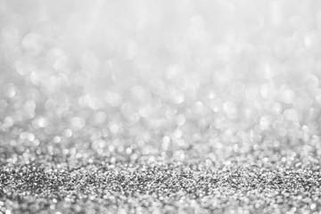 Abstract blur silver glitter sparkle defocused bokeh light background