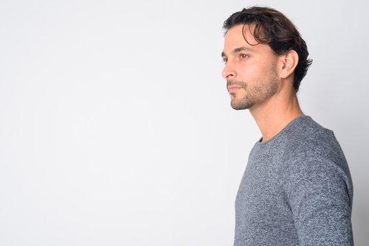 Closeup profile view of handsome Hispanic man thinking