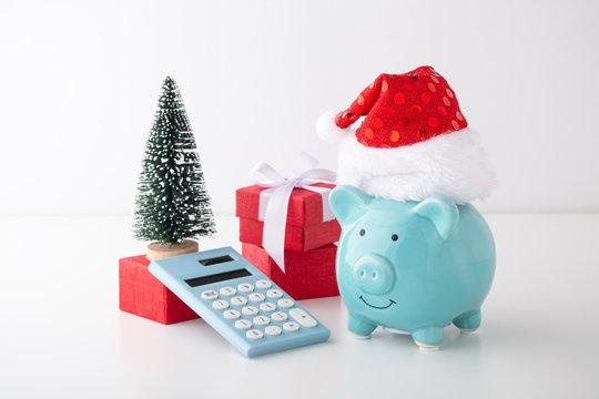 Piggy bank with calculator and christmas decor