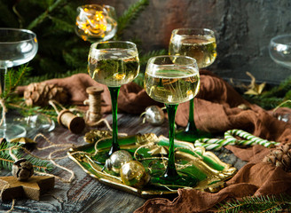 vintage wine glasses with champagne on old wooden green tray