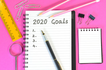 2020 Goals written on a diary on office desk