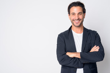 Portrait of happy handsome Hispanic businessman smiling with arms crossed Fototapete