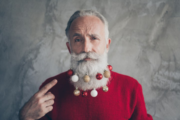 Photo of white haired old man x-mas party showing long beard with colorful balls in it not like...