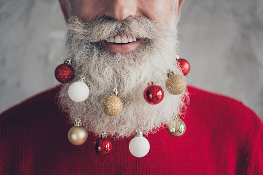 Closeup cropped photo concept of old positive santa claus man colorful toy balls in long beard x-mas decorations wear red pullover hipster outfit isolated grey color wall background