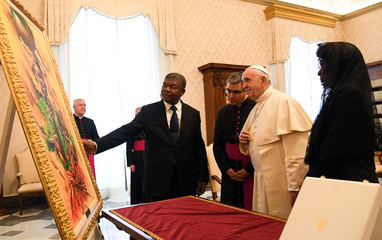 Pope Francis receives a gift from Angolan President Joao Lourenco and wife Ana Dias Lourenco at the Vatican
