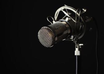 metal body microphone dark background studio shot