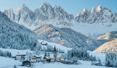 The small village in Dolomites mountains in winter. Wall mural