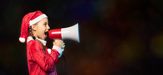Portrait of Little Adorable Girl in Costume Holding Megaphone fo
