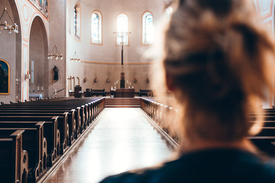 Woman in church heading to altar
