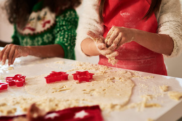 Close up of children making cookies for Christmas